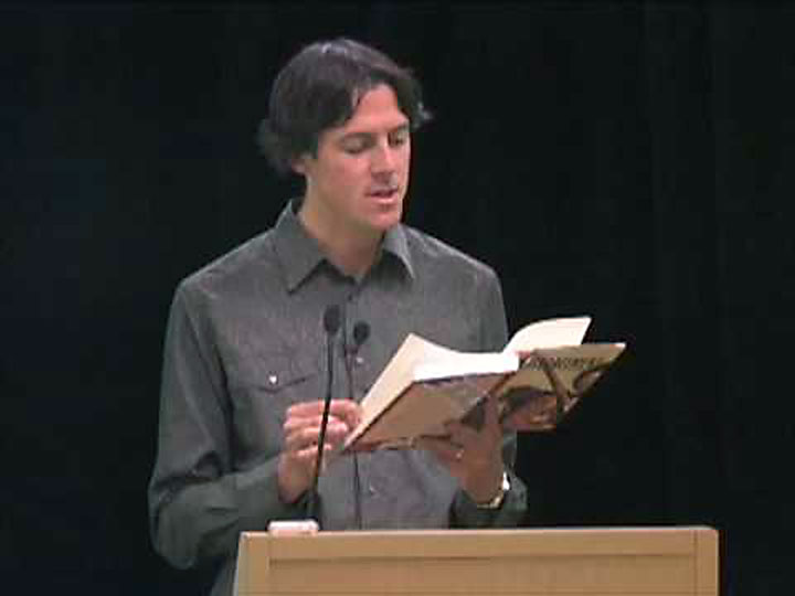 Nick Taylor shown reading from his novel about Junipero Serra