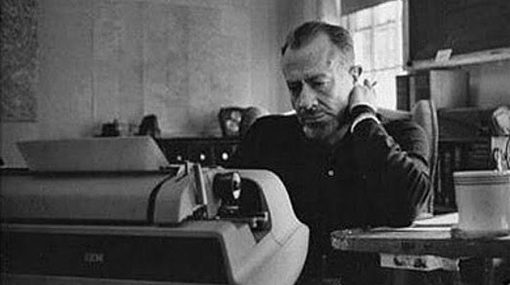 Image of John Steinbeck at his typewriter