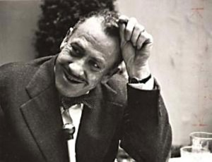 Image of John Steinbeck smiling for an audience