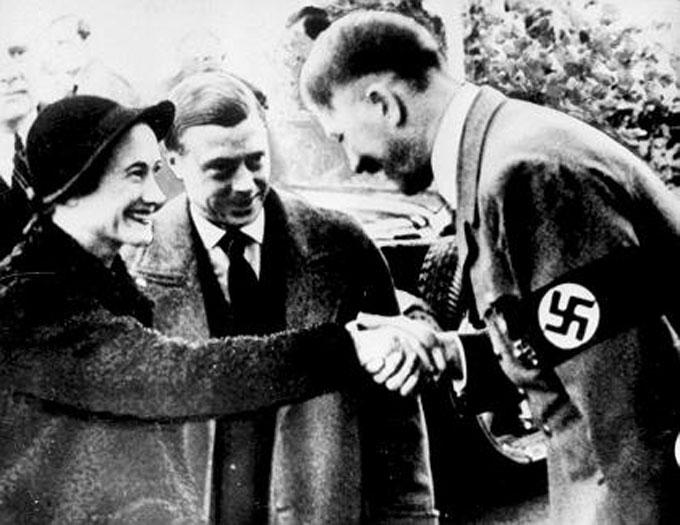 Image of Wallis Simpson and her husband greeting Adolf Hitler