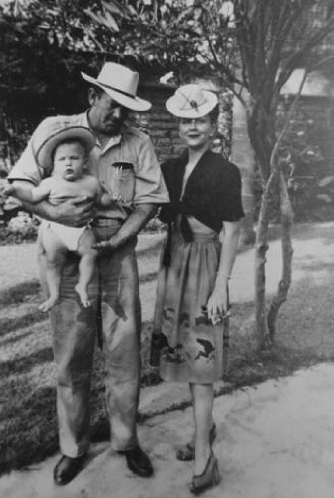 Image of John Steinbeck with son Thom and wife Gwyn in 1945
