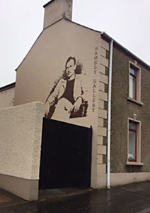 Imge of John Steinbeck mural in Bushmill's, Northern Ireland