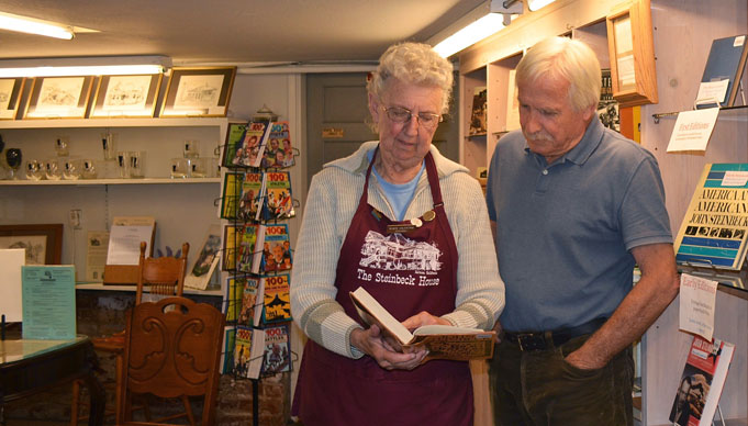 Image of John Steinbeck house gift shop volunteer and customer