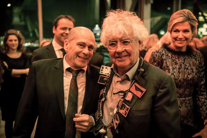 Image of Bill Steigerwald, Geert Mak, and Queen Maxima at award event in Holland